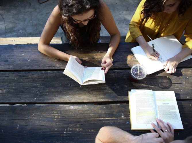 Students at picnic table. Photo by Alexis Brown on Unsplash